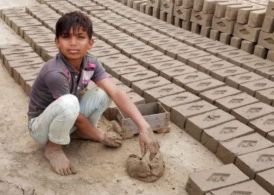 Impact Nations Boy Making Bricks