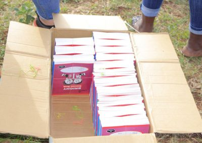 Impact Nations Children and Families Giving Away Books