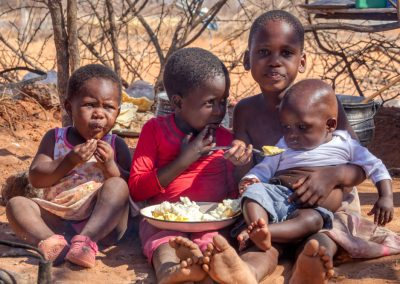 Impact Nations Children eating rice in Africa