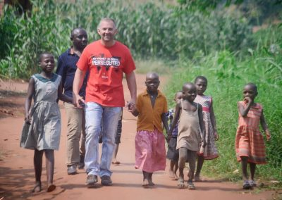 Impact Nations Evangelist Jeffrey Battles Holding Hands with Children