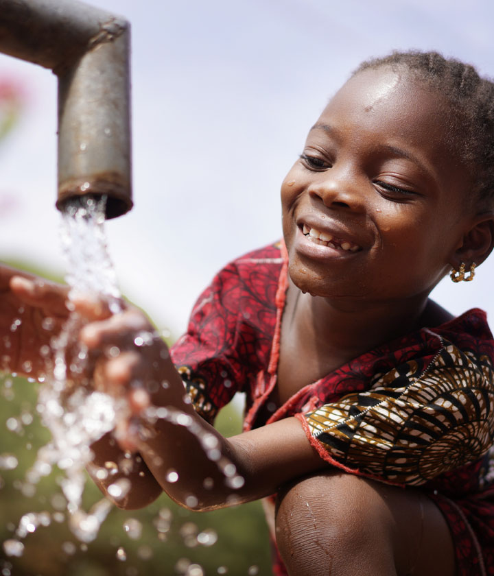 Impact Nations Global Thirsty Girl Drinking Clean Water from Pump
