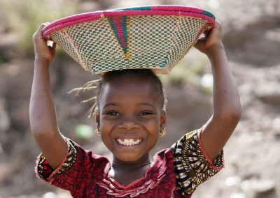 Impact Nations Hungry Beautiful African Child with Basket on Her Head