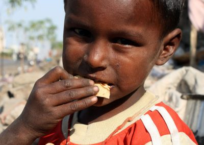 Impact Nations Hungry Indian Boy Being Fed