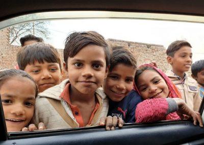 Impact Nations Poor Children Looking in Car Window in India